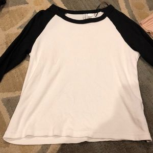 white tee with black sleeves